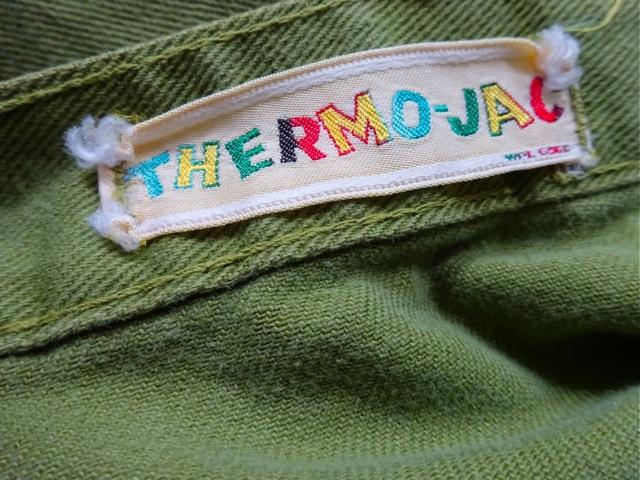 Green jeans vintage label